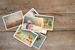 Summer photo album of remembrance and nostalgia on wood table. instant photo of film camera - vintage and retro style