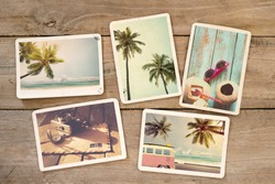 Summer photo album of remembrance and nostalgia on wood table. Photography from beach vacation. instant photo camera - vintage postcards and retro styles