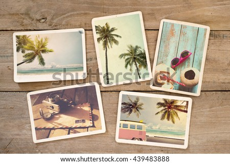 Summer photo album on wood table. Photography from beach vacation. instant photo camera - vintage postcards and retro styles