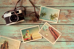 Summer photo album remembrance and nostalgia of journey honeymoon trip on wood table. instant photo of vintage camera - vintage and retro style