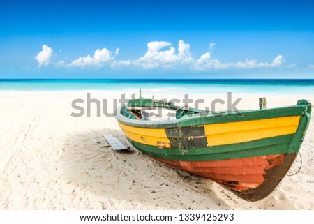 Summer photo of boat on sand and sea landscape. Free space for your decoration.  #1339425293