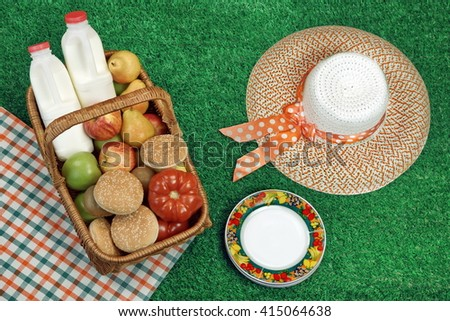 Summer Picnic Concept With Straw Hat And Food Basket On The Fresh Green Lawn Background, Overhead View