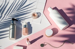 Summer pink cosmetics flat lay . Top view beauty composition