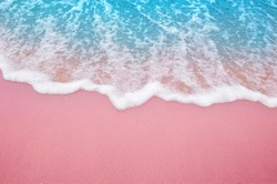 Summer pink sands beach with soft blue ocean wave and beautiful fine sand pink color