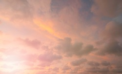 Summer pink Sky gloomy clouds background. Beautiful clear cloudy in sunlight spring season. Panoramic vivid cyan cloudscape in nature environment. Outdoor horizon skyline with spring morning sunshine.