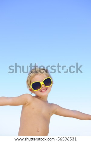summer portrait: happy child with sunglasses smiling
