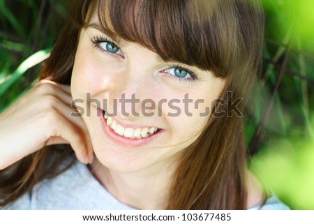 Summer portrait of happy young woman, close up