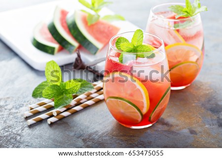 Summer refreshing cocktails with watermelon and citrus fruits