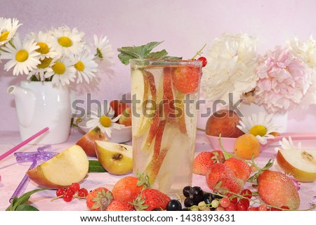 Summer refreshments and fruits, selective focus, Pear, apple lemonade and fresh tasty strawberries and pears, chamomile flowers and mint leaves on a sunny table #1438393631