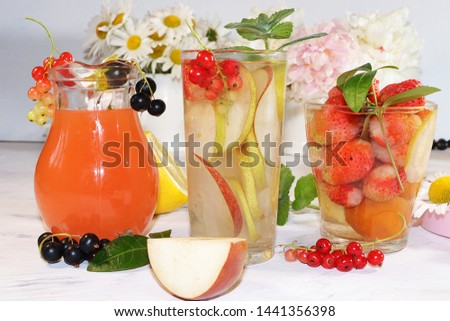 Summer refreshments and fruits, selective focus, top view, copy space ... Strawberry, pear, apple lemonade and fresh tasty strawberries and pears, chamomile flowers and mint leaves on a sunny table #1441356398