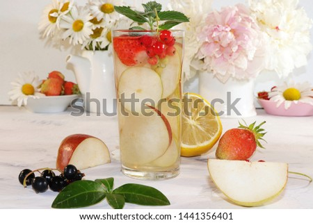 Summer refreshments and fruits, selective focus, top view, copy space ... Strawberry, pear, apple lemonade and fresh tasty strawberries and pears, chamomile flowers and mint leaves on a sunny table #1441356401