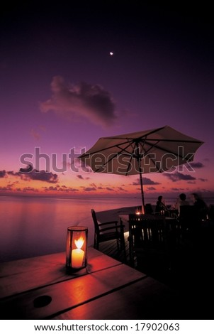 Summer Resort - beautiful glow of the setting sun in tropical island with happy tourists on a background of romantic colorful sky and water #17902063