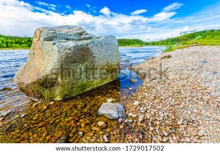 Summer river beach rock view