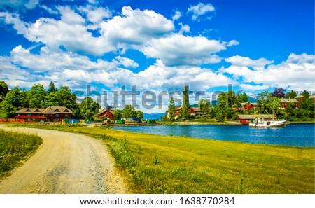 Summer river village road landscape. Village river road in summer.Village river road view