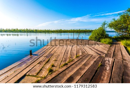 Summer river wooden pier landscape. River wooden pier view. Summer river nature landscape. Wooden pier at summer river #1179312583