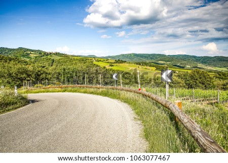 Summer road in Tuscany. Background of free space for your decoration.  #1063077467