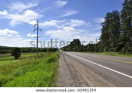 summer road with sky and power line