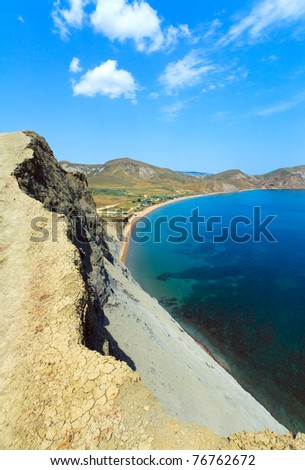 Summer rocky coastline and camping on sandy beach (Tihaja Bay, Crimea, Ukraine ). All peoples and cars is unrecognizable. - stock photo