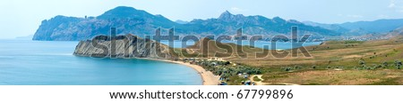 Summer rocky coastline and camping on sandy beach (Tihaja Bay (Koktebel Town on right), Crimea, Ukraine ). All peoples and cars is aunrecognizable. Four shots stitch image.