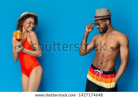 Summer romance. African millennials flirting, girl and guy falling in love at beach party, blue studio background #1427174648