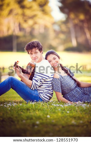 summer romance with guitar boy playing guitar for girl