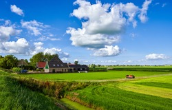 Summer rural farm field landscape. Farmland in summer scene. Summer rural farm house view. Farm house in farmland