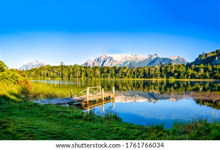 Summer rural lake pier landscape. Lake pier view. Summer lake pier landscape