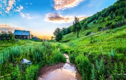 Summer rural river creek landscape. Sunrise rural river creek view. Rural creek in sunrise scene. Sunrise rural creek landscape