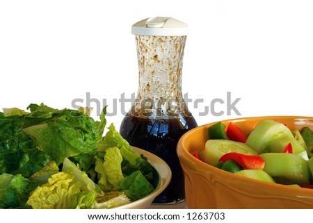 Summer Salad - Romain Lettuce, cruet of balsamic italian dressing and chopped peppers, cucumbers and tomatoes. Isolated for easy design use.