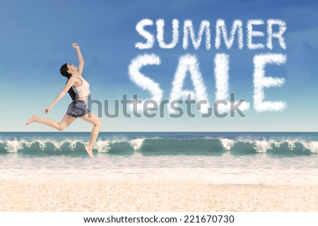 Summer sale clouds and woman jumping at beach #221670730