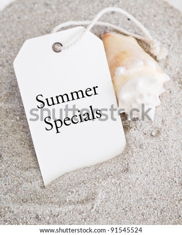 Summer Sales Tag on Sand with Shell