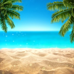 Summer sandy beach with blured tropical sea view with empty space for product display advertistment
