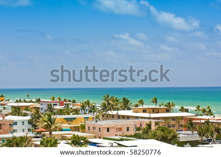 Summer scene with  colorful buildings and hotels  in Hollywood Beach, Florida with blue sky and ocean in the background