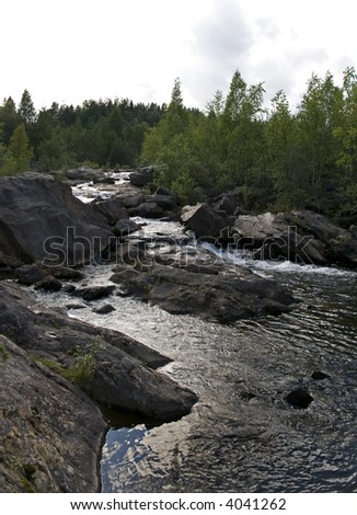 Summer scenery of remote rapids in Northern Sweden