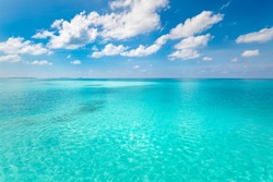 Summer sea beautiful of exotic tropical beach. Emerald green of the sea and bright blue sky with clouds with sunlight. Summer seascape, turquoise ocean water, idyll island or beach banner