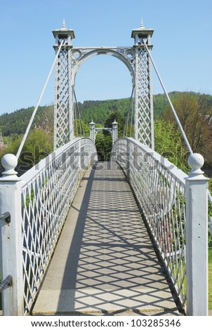 summer shadows on pedestrian bridge over the River Tweed at Peebles