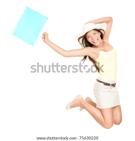 Summer shopping woman jumping of joy excited over the summer sales. Beautiful mixed race woman isolated on white background. Asian Chinese and Caucasian ethnicity.