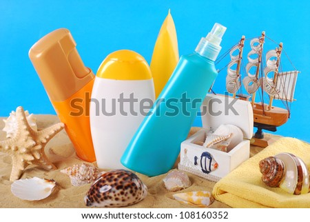summer skin care and sun protection cosmetics arranged on the beach
