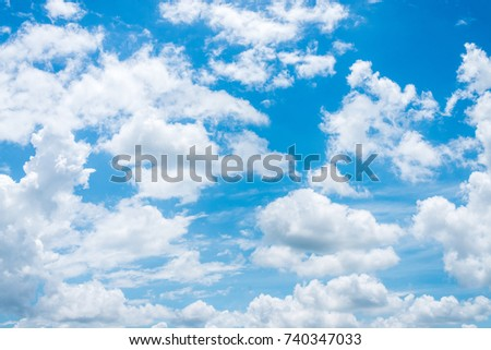 Summer sky and beautiful sun in the blue sky with clouds. - Shutterstock ID 740347033