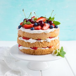 summer sponge cake with cream and fresh berries. Selective focus. square image