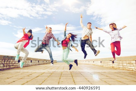 Shutterstock summer, sport, dancing and teenage lifestyle concept - group of teenagers jumping