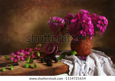 Summer still life with Phlox and BlackBerry and clematis