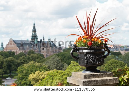 Summer Stockholm flowers on architecture background