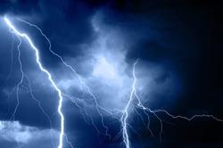 Summer storm bringing thunder, lightnings and rain.