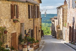 Summer streets in the medieval Tuscan town.