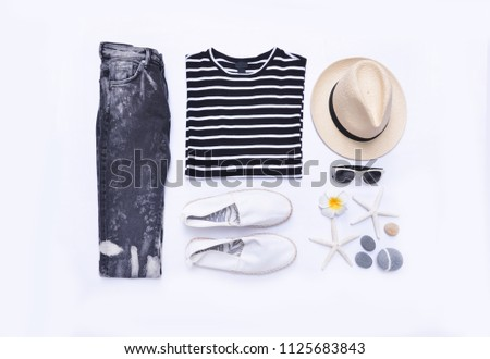 summer striped clothes collage on white,sunglasses,starfish, , hat, shoes ,stone, frangipani ,jeans on flat lay, top view