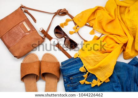 Summer style. Fashion summer girl clothes set, accessories. Trendy sunglasses, slippers, handbag clutch,  watch, jeans, scarf. Summer lady. Creative urban overhead summer top view
