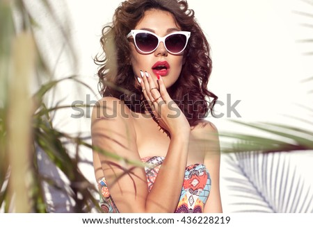 Summer style portrait of young attractive surprised woman wearing sunglasses. Tropical summer holiday fashion beauty  concept