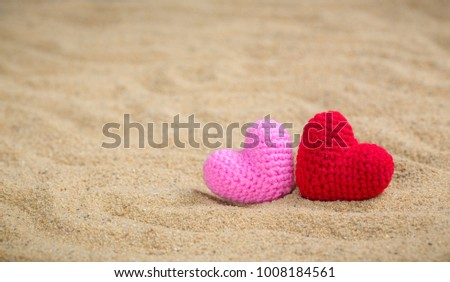 Summer style with Red and Pink Heart Knitting on a sea sand. background for add text. Backdrop love valentine greeting card concept. #1008184561