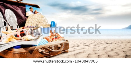 Summer suitcase on beach and free space for your decoration.
